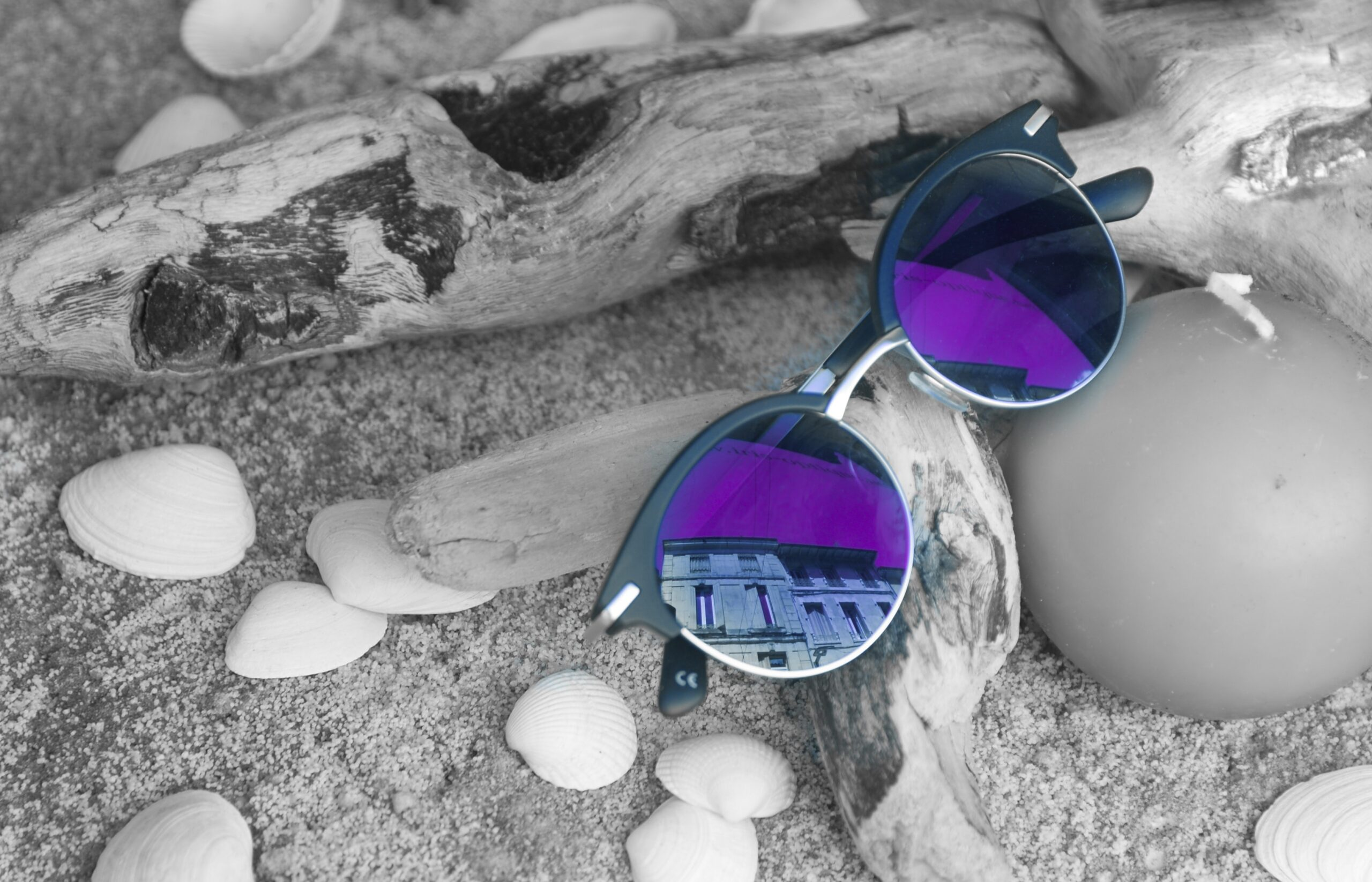 colorful sunglasses on beach