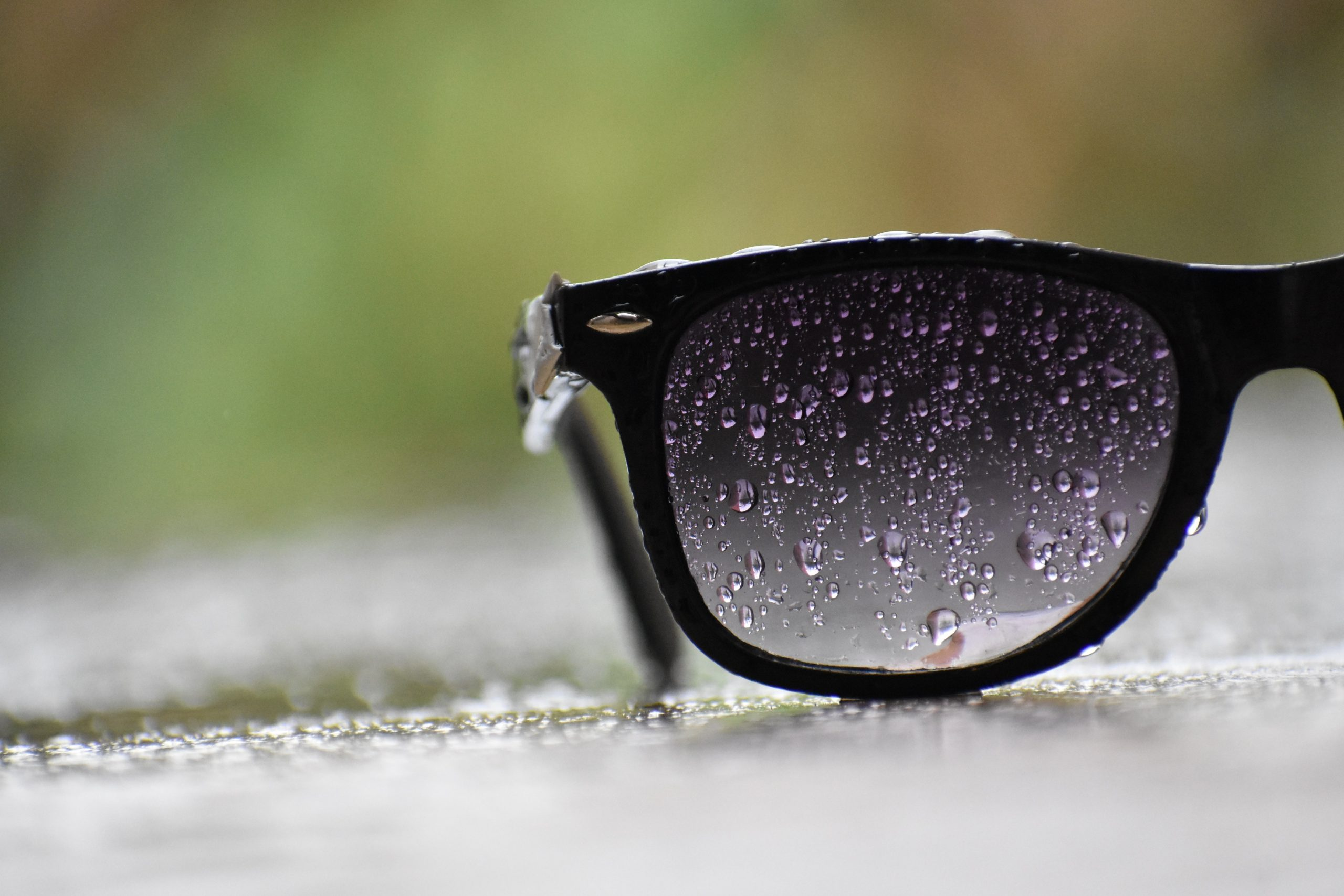 black-sunglasses-with-water-droplets